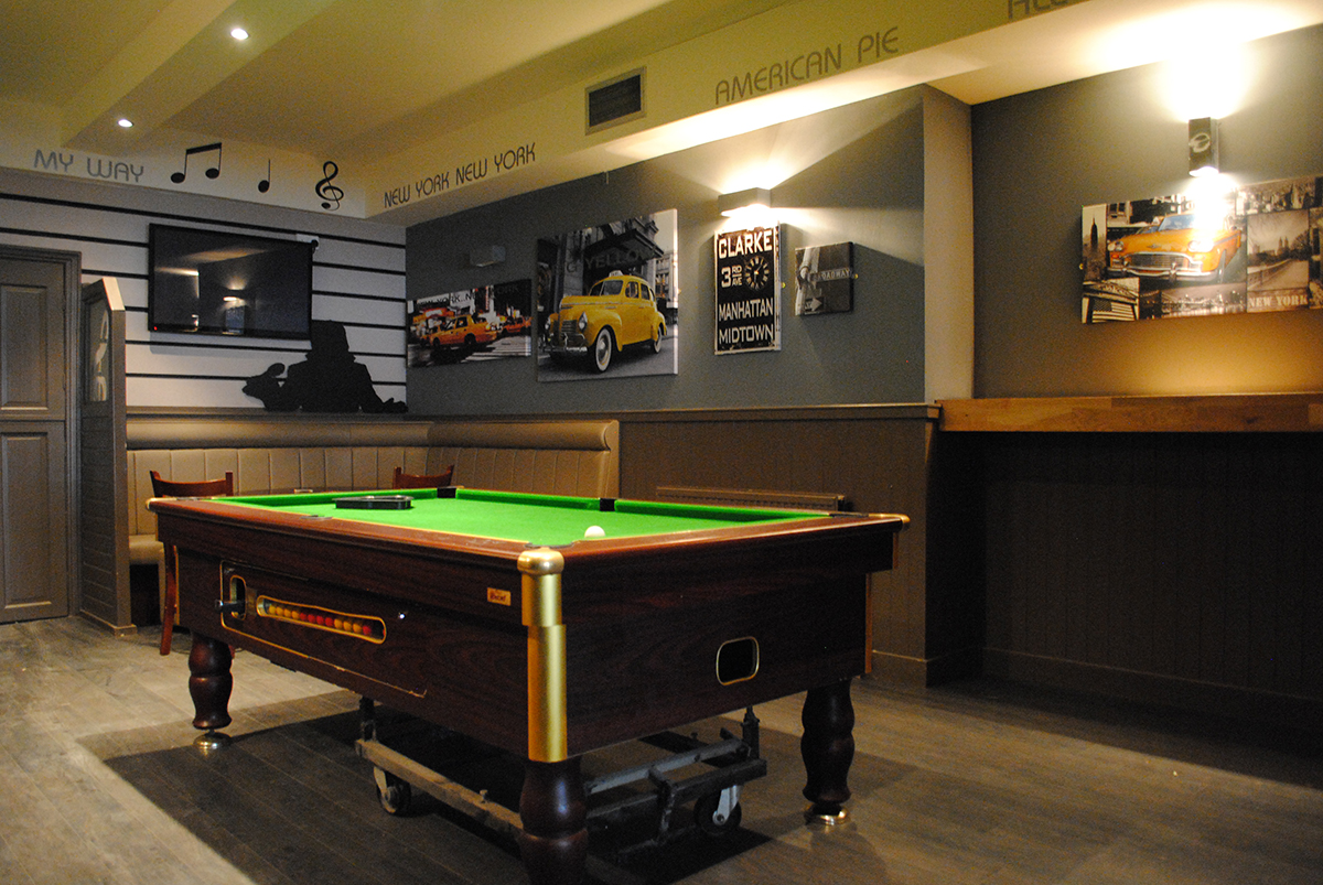 Enjoy your drink over a game of pool