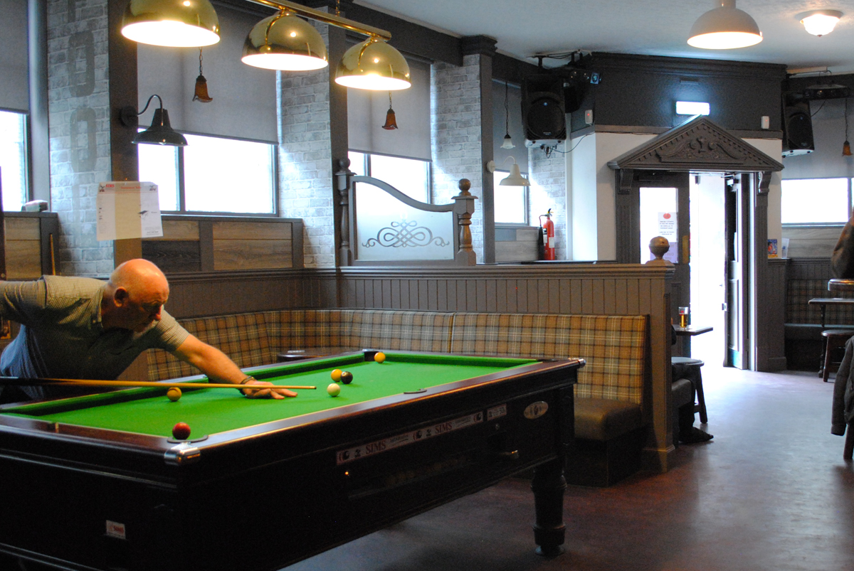 Enjoy your pint over a game of pool